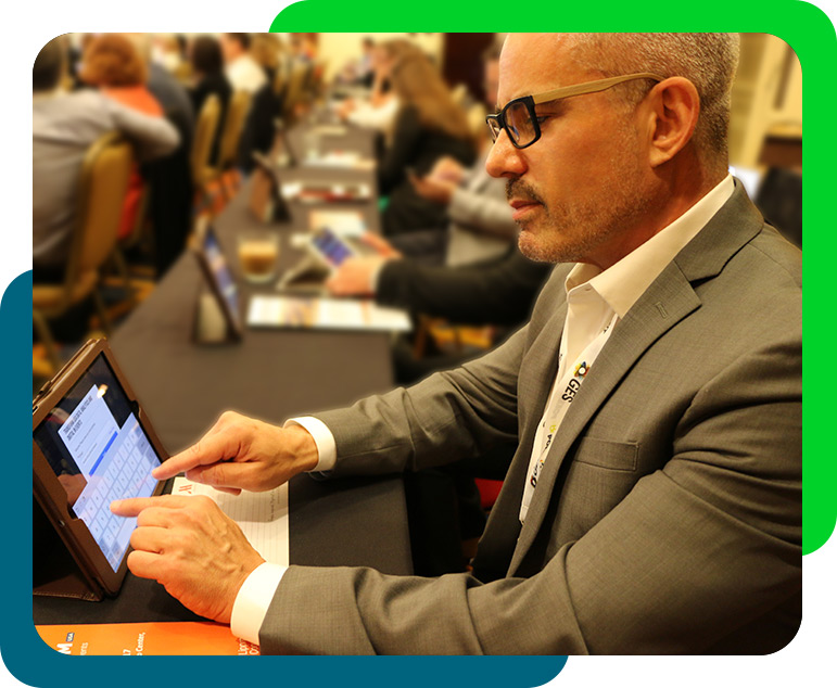 man using ipads at an in-person life sciences event